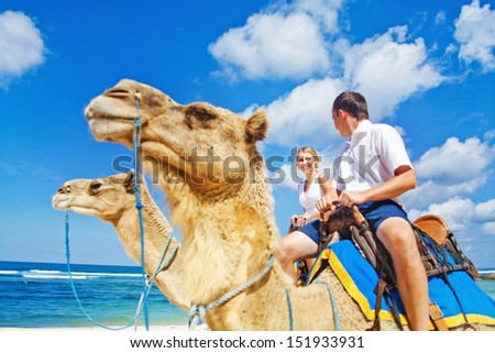 camel ride on wedding day (focus on face of bride) - stock photo