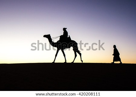 Camel rider silhouette at sunrise. Meroe, Sudan - 18/DEC/2015