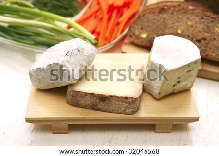 camembert and brie cheeses on plate