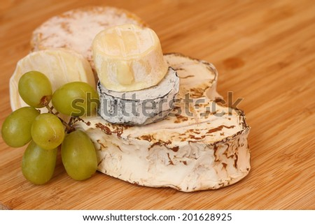 Camembert cheese on wooden board close-up