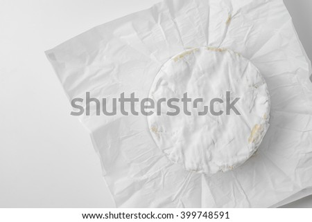 camembert cheese on wrapping paper