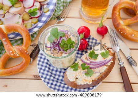 Camembert with onions and spices on bread, Bavarian recipe
