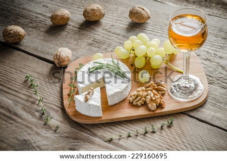 Camembert with walnuts and grape - stock photo