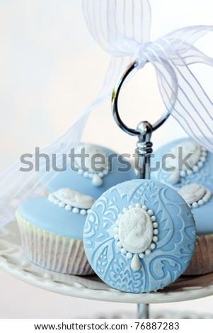 Cameo cupcakes - stock photo