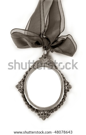 Cameo silver locket with tape loop copy space isolated on white - stock photo