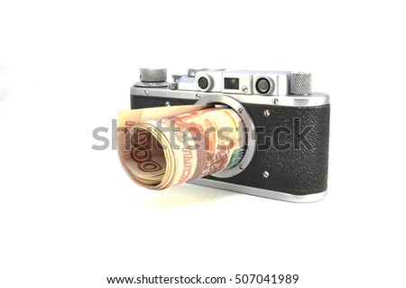 Camera and rubles. Business. Finance. Currencies. Profit. Work. Notes
