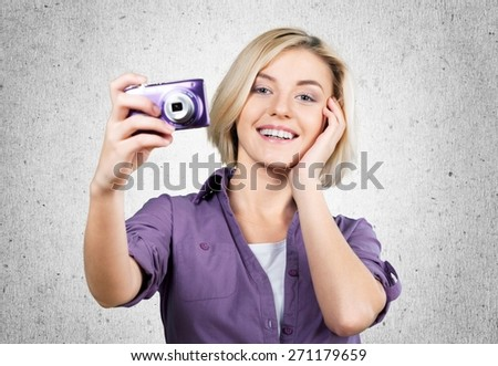 Camera. Attractive Young Woman with Digital Camera - stock photo