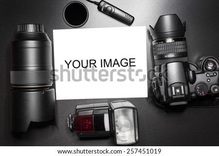 Camera equipment around a printed photo (copy-space to insert your image) - In this photo the logos, brand, or anything that can bring to a particular object has been deleted to be 100% commercial. - stock photo