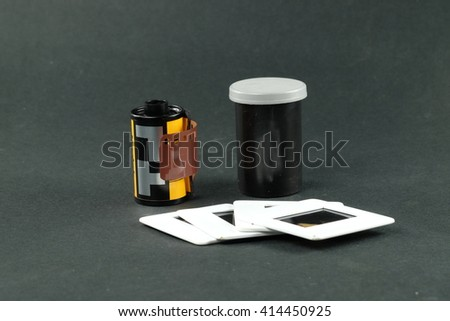 Camera film roll and mount slide positive film - stock photo