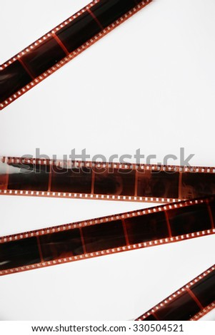 Camera film strips on white background