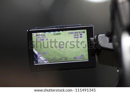 Camera filming soccer stadium - stock photo