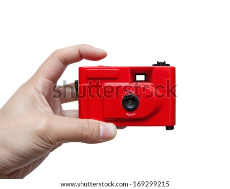 Camera in a hand isolated on white background - stock photo