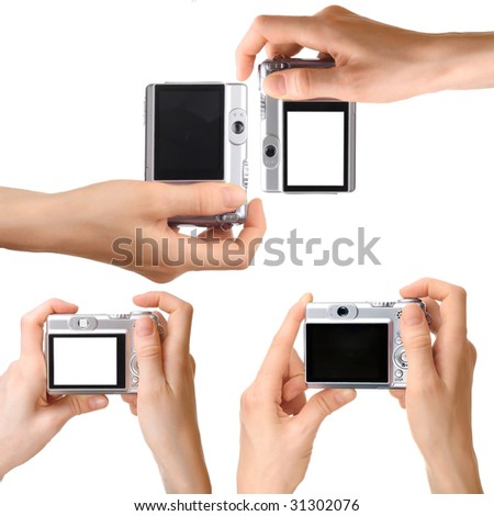 Camera in hand - stock photo