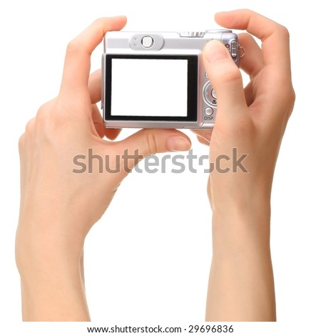 Camera in hands - stock photo