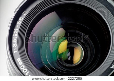 Camera lens closeup: this sample is from an SLR (single lens reflex). - stock photo