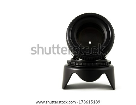 Camera lens on lens hood isolated on white background.