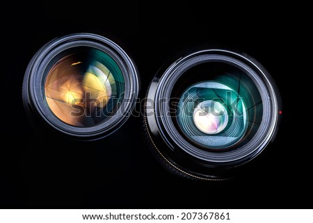 Camera Lens only isolated on black background - stock photo