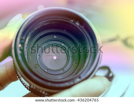 camera lens with vintage color style - stock photo