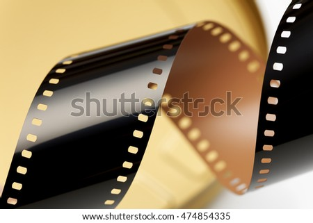 Camera negative film. Selective focus on film perforation. Unprocessed color motion picture film. Industry symbol for shooting process, photochemical laboratory process and film archive technology.