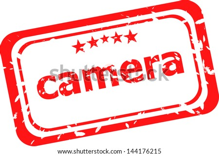 camera on red rubber stamp over a white background, raster