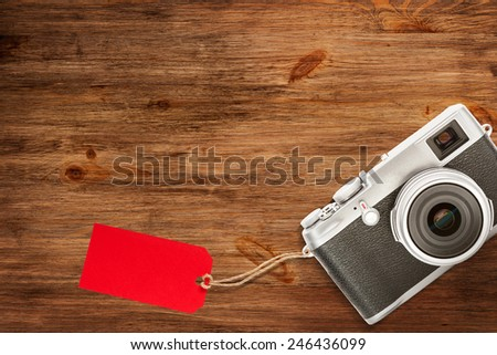 Camera on table with sale tag - stock photo