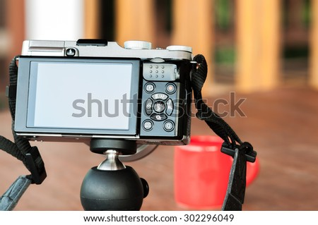 camera on the table with coffee cup