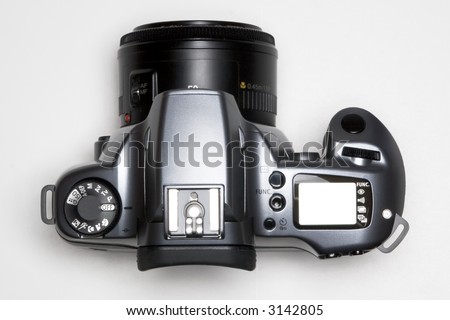 camera on white backdrop viewed from top - stock photo