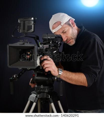 camera operator working with a cinema camera - stock photo