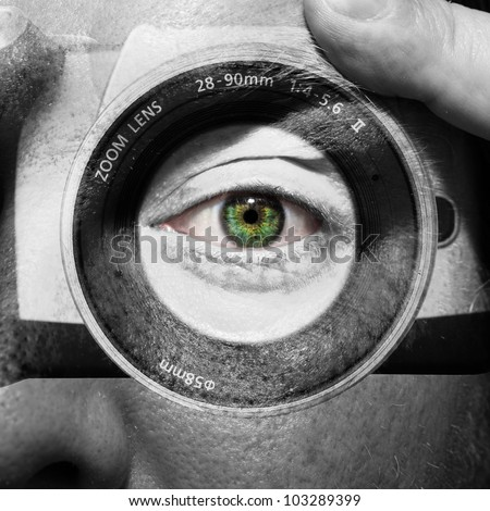 Camera painted on male face with green eyes - stock photo