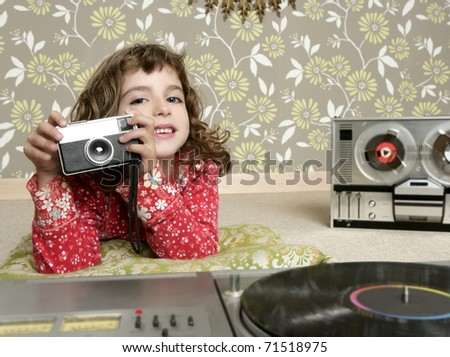 camera retro photo little girl in vintage room wallpaper - stock photo