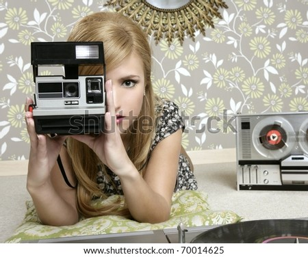camera retro photo woman in vintage room wallpaper - stock photo