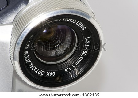 Camera's lens (with star-shaped shiny light on top left) - stock photo