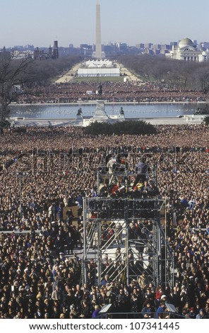 Camera stands and crowd on Bill Clinton's Inauguration Day January 20, 1993 in Washington, DC - stock photo