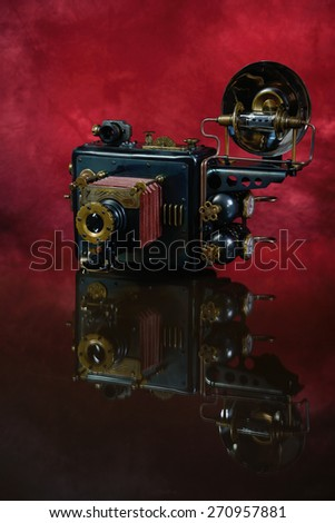 Camera steampunk on a red background.  - stock photo