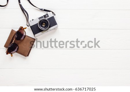 camera sunglasses and wallet on white wooden background top view. travel and wanderlust concept,flat lay. planning summer vacation. time for summertime holidays. space for text