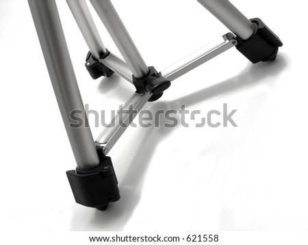 Camera tripod legs - stock photo