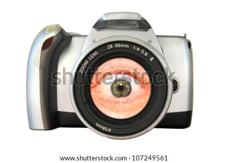 Camera with an eye in the zoom lens. Concept: An eye for photography - stock photo