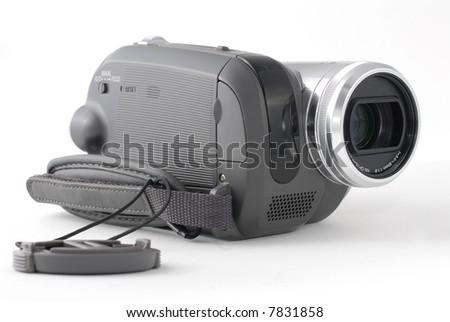 Camera with lens cap - stock photo