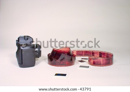 Camera with slides and film. - stock photo