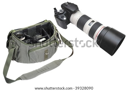 camera with teleobjective lens and bag under the white background - stock photo