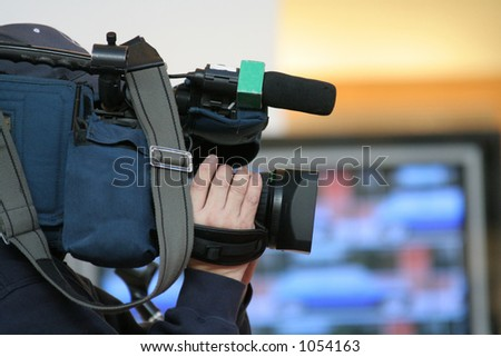cameraman and newscast - stock photo