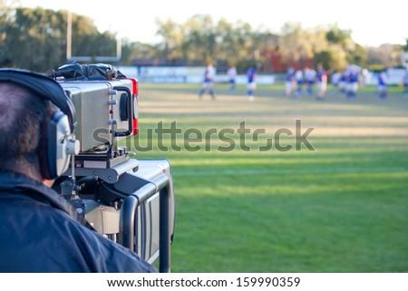 Cameraman filming sport - stock photo