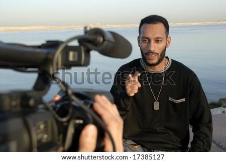 Cameraman & Host - stock photo