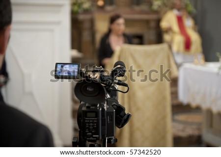 Cameraman recording video of a marriage - stock photo