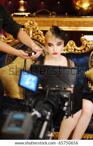cameraman shooting film with beauty girl - stock photo