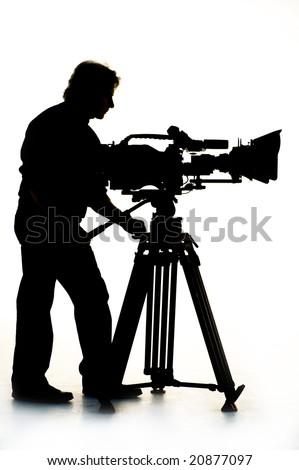 Cameraman silhouette and cameras. - stock photo