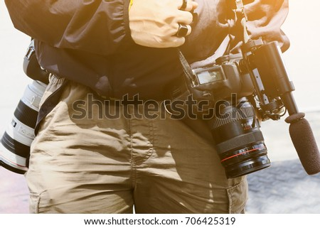 Cameraman with his video camera shooting