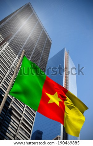 Cameroon national flag against low angle view of skyscrapers