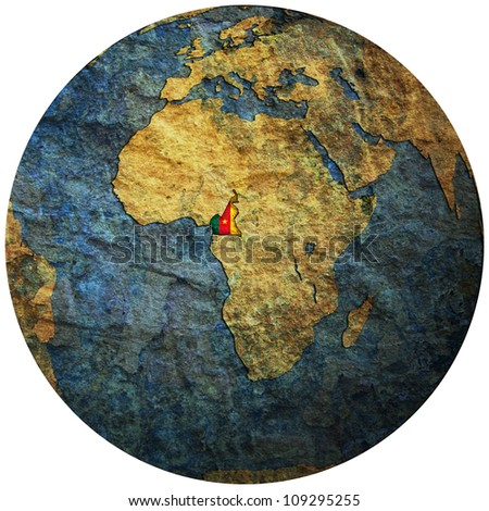 cameroon territory with flag on map of globe isolated over white