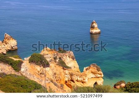 Camilo beach and rocky sea coast in Lagos, Algarve, Portugal
